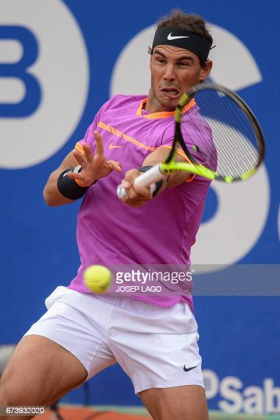 Spanish tennis player Rafael Nadal returns the ball to South African tennis player Kevin Anderson during the ATP Barcelona Open 'Conde de Godo'...