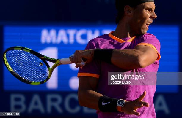 TOPSHOT Spanish tennis player Rafael Nadal returns the ball to South Korean tennis player Hyeon Chung during the ATP Barcelona Open 'Conde de Godo'...
