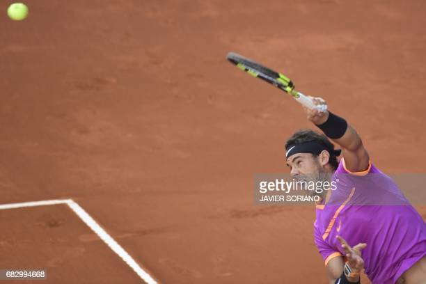 Spanish tennis player Rafael Nadal serves to Austrian tennis player Dominic Thiem during their ATP Madrid Open final match in Madrid on May 14 2017 /...
