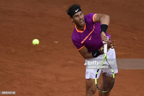 Spanish tennis player Rafael Nadal serves to Austrian tennis player Dominic Thiem during their ATP Madrid Open final match in Madrid on May 14 2017...