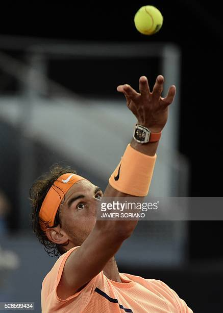 Spanish tennis player Rafael Nadal serves to Portuguese tennis player Joao Sousa during the Madrid Open tournament at the Caja Magica sports complex...