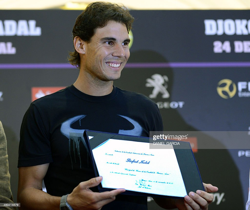 Spanish tennis player Rafael Nadal shows his diploma after he was appointed Honorary Guest of the city of Buenos Aires on November 18, 2013. Nadal visits Argentina to face Novak Djokovic in an exhibition match and participate in the farewell celebration for Argentine tennis player David Nalbandian.