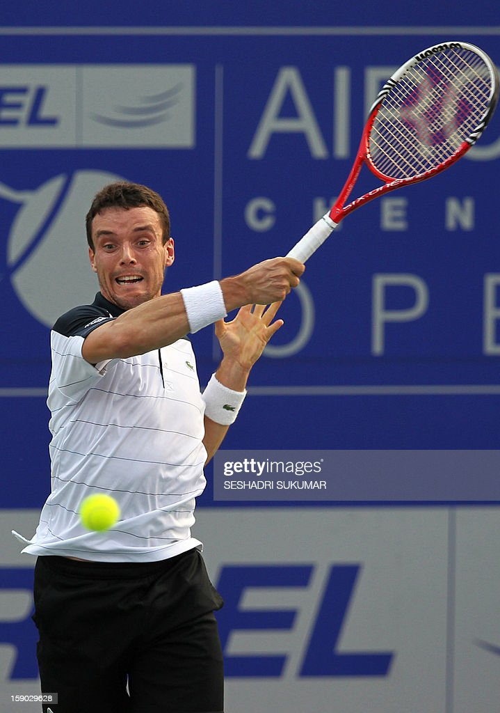 Spanish tennis player Roberto Bautista-Agut plays a return to Serbian opponent Janko Tipsarevic during their final match at the ATP Chennai Open 2013 in Chennai on January 6, 2013. AFP PHOTO/Seshadri SUKUMAR