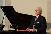 Spanish tenor Josep Carreras performs on stage at the Parliament of Catalunya on September 9 2014 in Barcelona Spain
