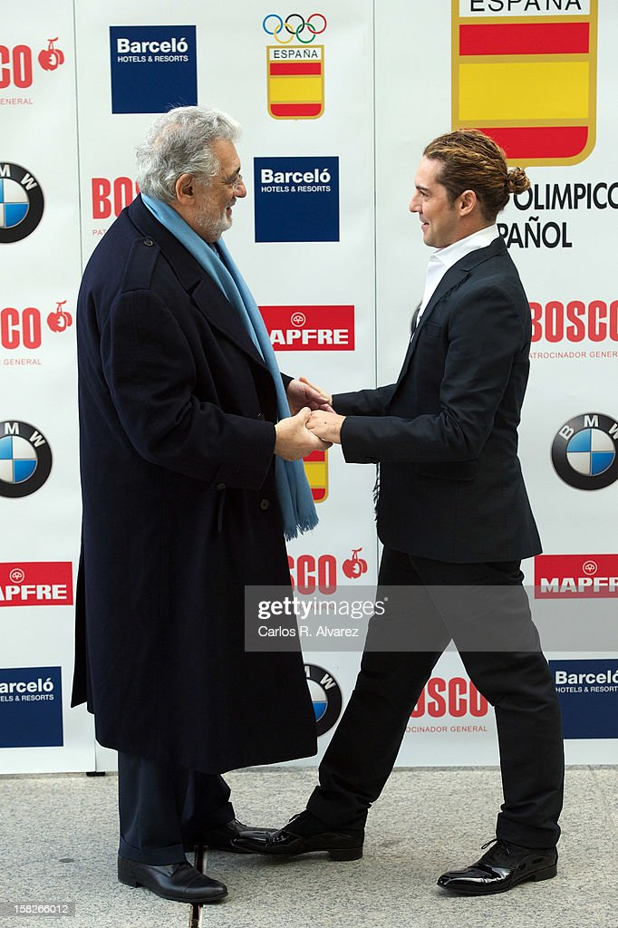 Spanish tenor Placido Domingo (L) and Spanish singer David Bisbal (R) attend Spanish Olympic Commitee Centenary Gala at El Canal theater on December 12, 2012 in Madrid, Spain.