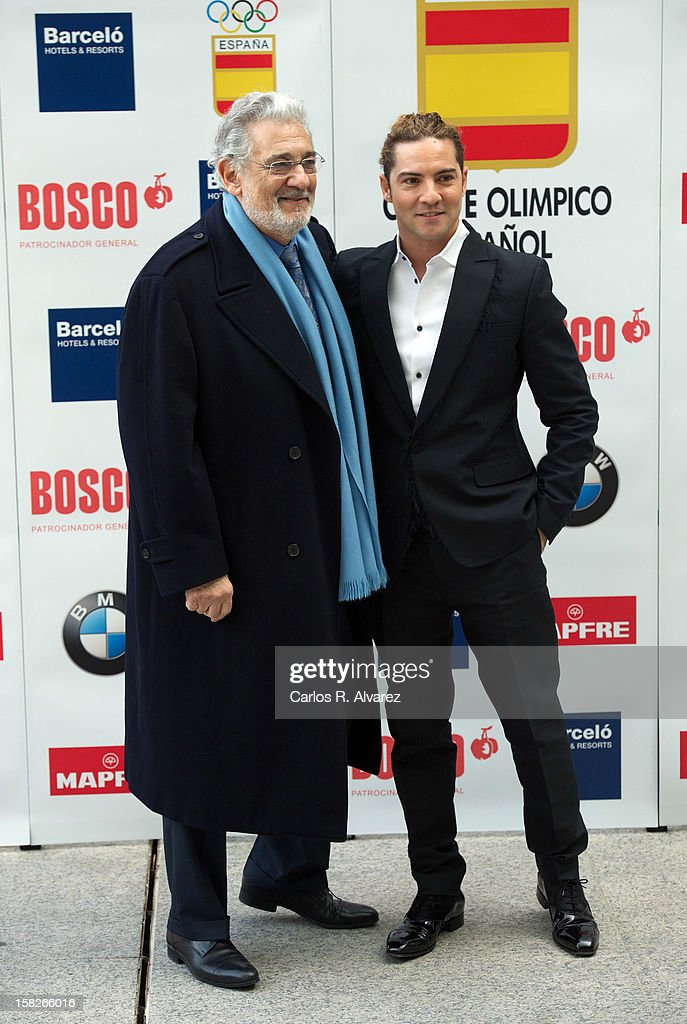 Spanish tenor <a gi-track='captionPersonalityLinkClicked' href=/galleries/search?phrase=Placido+Domingo&family=editorial&specificpeople=204571 ng-click='$event.stopPropagation()'>Placido Domingo</a> (L) and Spanish singer <a gi-track='captionPersonalityLinkClicked' href=/galleries/search?phrase=David+Bisbal&family=editorial&specificpeople=206469 ng-click='$event.stopPropagation()'>David Bisbal</a> (R) attend Spanish Olympic Commitee Centenary Gala at El Canal theater on December 12, 2012 in Madrid, Spain.