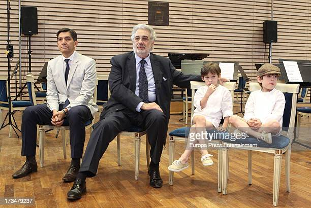 Spanish tenor Placido Domingo his doctor Carlos Gonzalez and his grandsons attend a press conference before attending a dress rehearsal of Daniel...