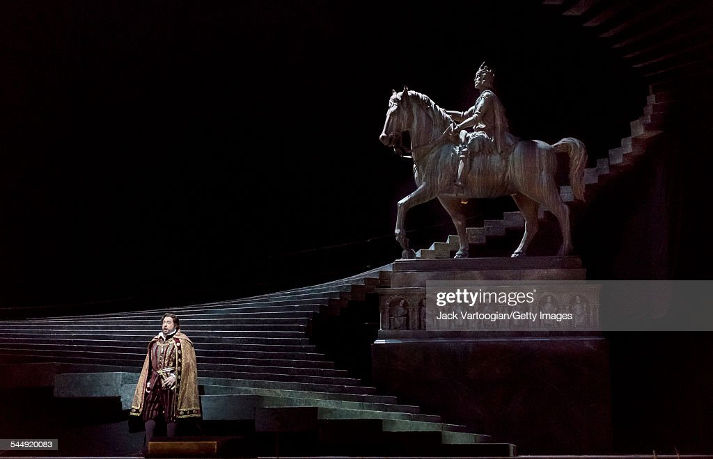 Spanish tenor <a gi-track='captionPersonalityLinkClicked' href=/galleries/search?phrase=Placido+Domingo&family=editorial&specificpeople=204571 ng-click='$event.stopPropagation()'>Placido Domingo</a> (as 'Don Carlo, King of Spain') performs in a scene at the tomb of <a gi-track='captionPersonalityLinkClicked' href=/galleries/search?phrase=Charlemagne&family=editorial&specificpeople=79057 ng-click='$event.stopPropagation()'>Charlemagne</a> during the final dress rehearsal prior to the season premiere of the Metropolitan Opera/Pier Luigi Samaritani production of 'Ernani' (by Giuseppe Verdi, 1844) at the Metropolitan Opera House at Lincoln Center, New York, New York, March 17, 2015. It was Domingo's 146th role, and his first as the baritone role of Don Carlo.