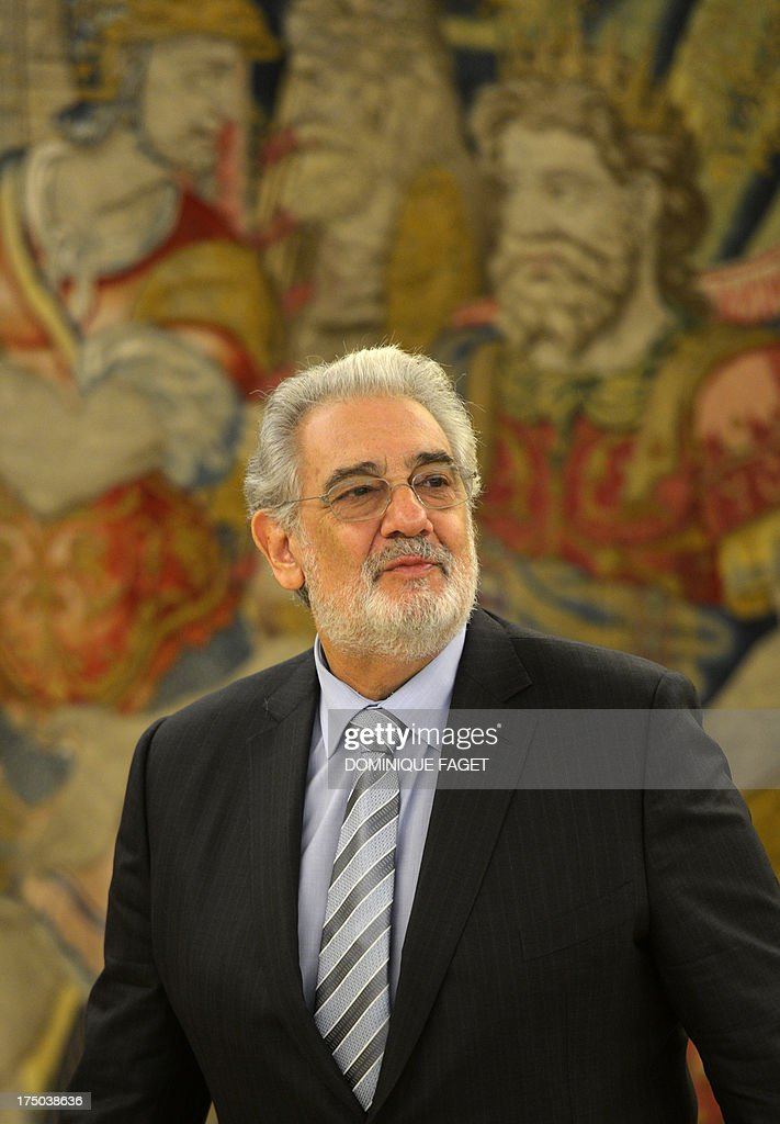 Spanish tenor Placido Domingo poses during a meeting with Spain's King Juan Carlos at the Zarzuela Palace in Madrid on July 29, 2013. Domingo is feeling well after a treatment for a blockage in his lung two weeks ago. The 72-year-old, popularly known for his 'Three Tenors' performances with Jose Carreras and the late Luciano Pavarotti, was admitted to hospital in the Spanish capital on July 8, 2013 and treated for a pulmonary embolism. AFP PHOTO/ DOMINIQUE FAGET