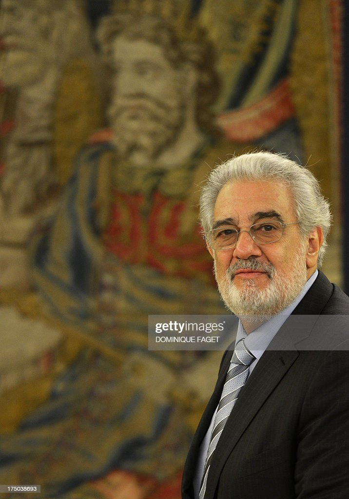 Spanish tenor Placido Domingo poses during a meeting with Spain's King Juan Carlos at the Zarzuela Palace in Madrid on July 29, 2013. Domingo is feeling well after a treatment for a blockage in his lung two weeks ago. The 72-year-old, popularly known for his 'Three Tenors' performances with Jose Carreras and the late Luciano Pavarotti, was admitted to hospital in the Spanish capital on July 8, 2013 and treated for a pulmonary embolism.