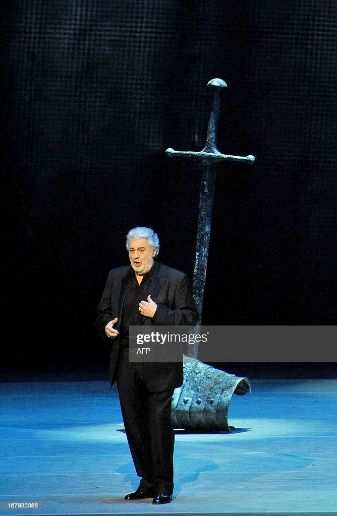 Spanish tenor Placido Domingo sings during a dress rehearsal on May 1, 2013 before the Grand gala dedicated to the opening of the new stage Mariinsky II theatre in St. Petersburg. Russia's famous Mariinsky theatre in Saint Petersburg was to inaugurate a new ballet and opera house on May 2 in an event coinciding with the 60th birthday of its hugely ambitious and well-connected director Valery Gergiev. AFP PHOPTO / OLGA MALTSEVA