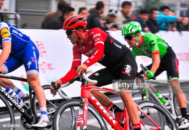 Spanish twotime Tour de France winner Alberto Contador negotiates a curve during the China Criterium in Shanghai on October 29 2017 Tour de France...
