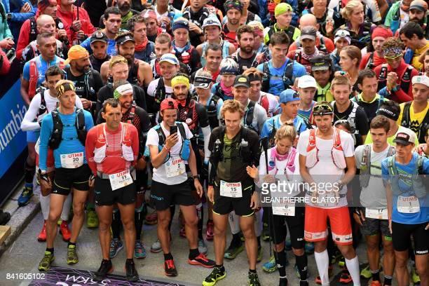 Spanish Ultratrailer and former Mount Blanc Ultra Trail winner Kilian Jornet waits with runners for the start of the 170 km Mount Blanc Ultra Trail...