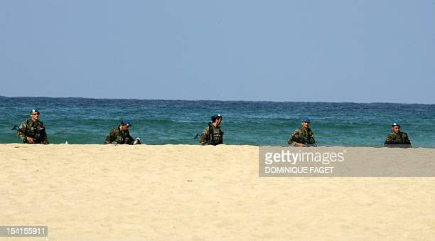 Spanish UNIFIL troops walk on the beach after landing in the southern Lebanese port city of Tyre 15 September 2006 A first contingent of Spanish...