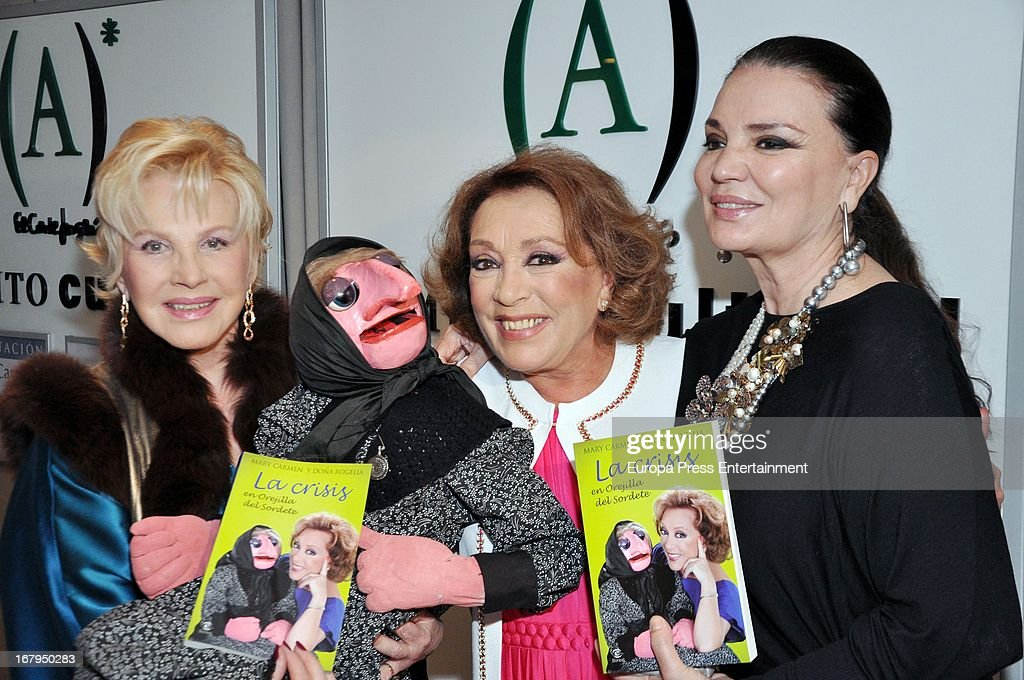 Spanish ventriloquist Mari Carmen (C), her doll Dona Rogelia, Marili Coll (L9 and Maria Jose Cantudo (R) present the book 'La Crisis En Orejilla Del Sordete' on April 30, 2013 in Madrid, Spain.