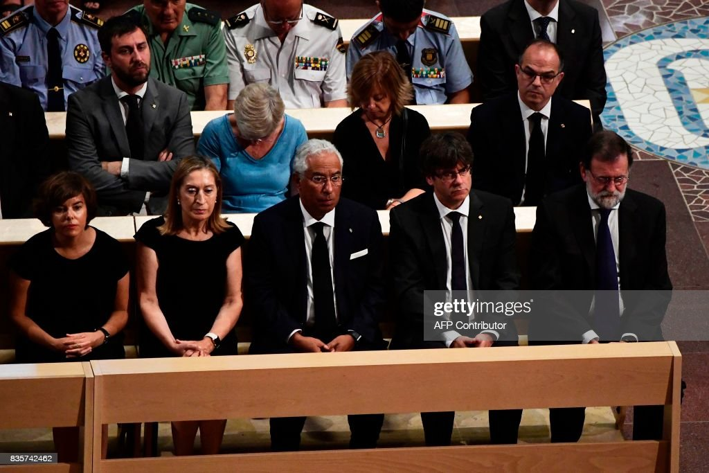 Spanish vice-President of the Government and Minister of the Presidency and of the Regional Administrations Soraya Saenz de Santamaria, President of the Congress Ana Pastor, Portugal's Prime Minister Antonio Costa, President of Catalonia Carles Puigdemont and Spanish Prime Minister Mariano Rajoy attend a mass to commemorate victims of two devastating terror attacks in Barcelona and Cambrils, at the Sagrada Familia church in Barcelona on August 20, 2017. A grief-stricken Barcelona prepared today to commemorate victims of two devastating terror attacks at a mass in the city's Sagrada Familia church. As investigators scrambled to piece together the attacks which killed 14 people in all, Interior Minister Juan Ignacio Zoido said on August 19 the cell behind the carnage that also injured 120 and plunged the country into shock had been 'dismantled,' though local authorities took a more cautious tone. SORIANO