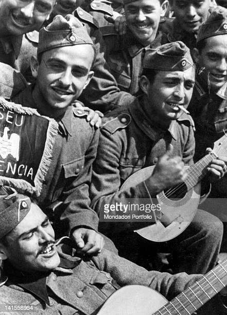 Spanish volunteers of the 'Blue Division' incorporated into the Wehrmacht on the Russian front singing songs from their home country in a moment of...