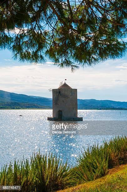 Spanish windmill on lagoon of Orbetello, Orbetello, Grosseto province, Tuscany, Italy