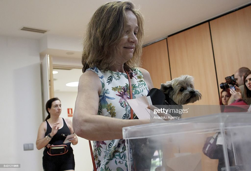 A Spanish woman casts her ballot during the Spanish General elections at a polling station in Madrid on June 26, 2016.