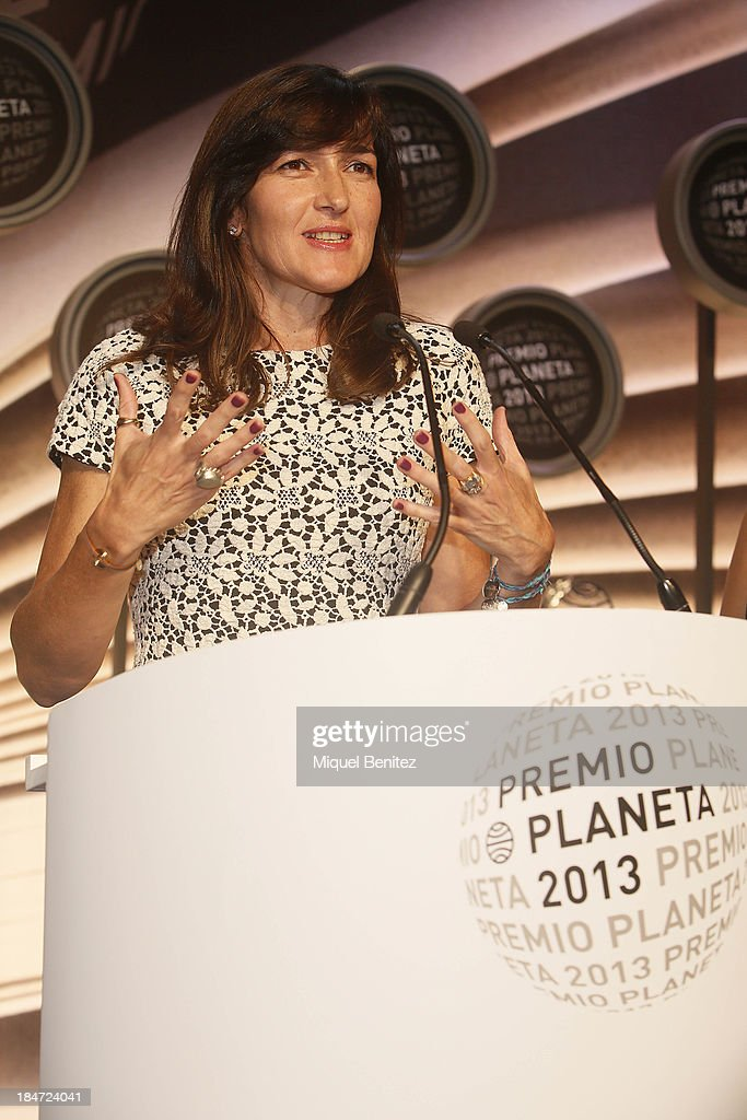 Spanish writer Angeles GonzalezSinde gives a speech as finalist of the '62nd Premio Planeta' Literature Awards the most valuable literature award in...