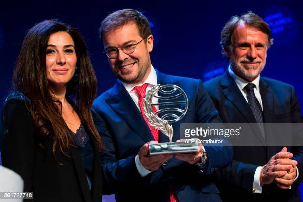 Spanish writer Javier Sierra winner of the Spain's 2017 'Premio Planeta' award for his book 'El Fuego Invisible' poses with Spanish writer Cristina...