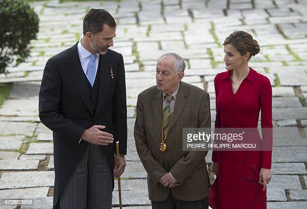 Spanish writer Juan Goytisolo poses flanked by Spain's Queen Letizia and Spain's King Felipe VI after receiving the Cervantes Literature award at the...