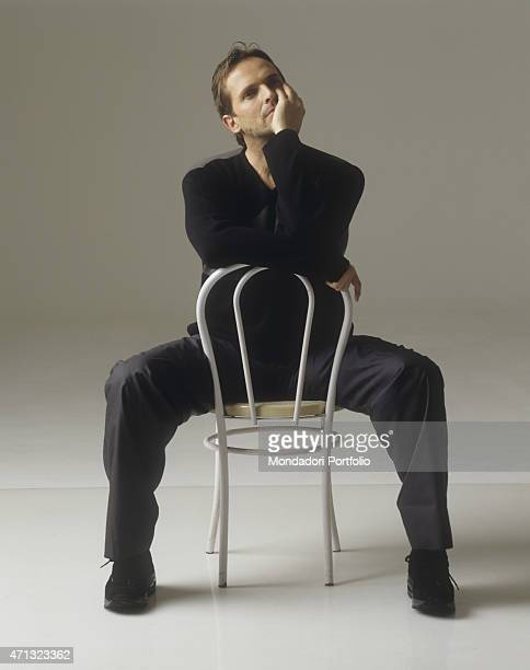 Spanishborn Italian singer and TV presenter Miguel Bos sitting thoughtful 1999
