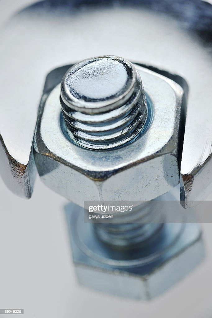 spanner tightening a bolt on white