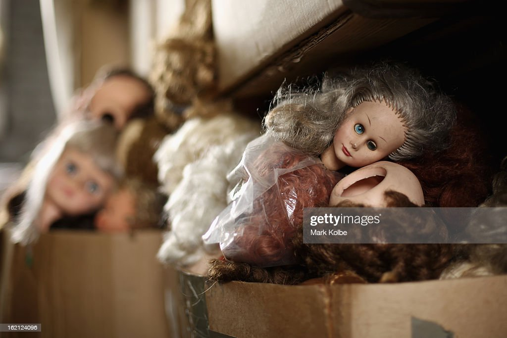 Spare doll heads are seen in cardboard boxes at Sydney's Original Doll Hospital in Bexley on February 19, 2013 in Sydney, Australia. Established in 1913 by Harold Chapman Jnr the Doll hospital is now run by Geoff Chapman, the third generation of Chapmans to run the business and will celebrate 100 years of repairing all types of dolls, teddy bears, rocking horses, umbrellas, prams and various other items.