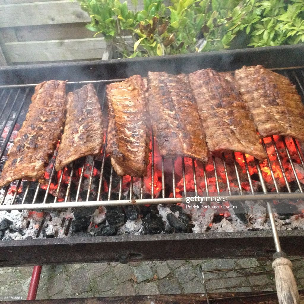 Spare Ribs On Smoking Charcoal Grill