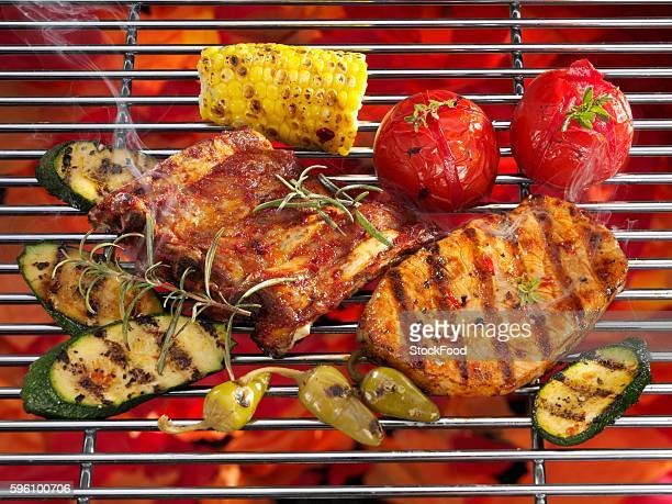 Spare ribs, steak and vegetables on a grill