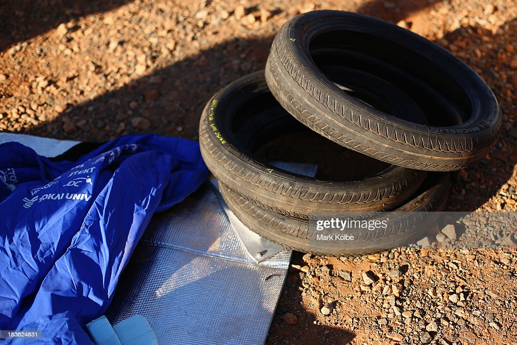 Spare tyres of Tokai Challenger are seen from Tokai University in Japan before the start of racing on Day 3 on October 8, 2013 outside of Ti Tree, Australia. Over 25 teams from across the globe are competing in the 2013 World Solar Challenge - a 3000 km solar-powered vehicle race between Darwin and Adelaide. The race began on October 6th with the first car expected to cross the finish line on October 10th.