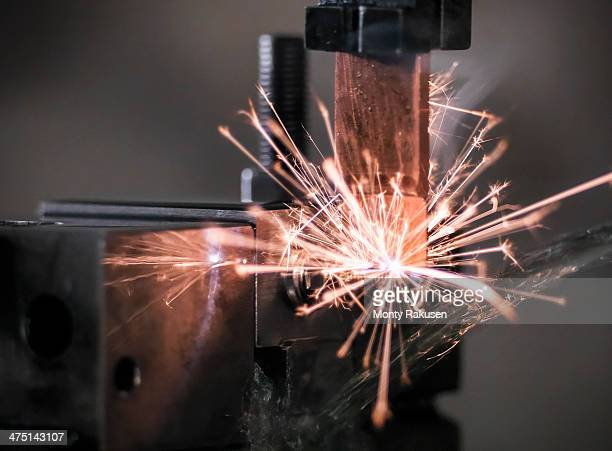 Spark from wire erosion machine in factory