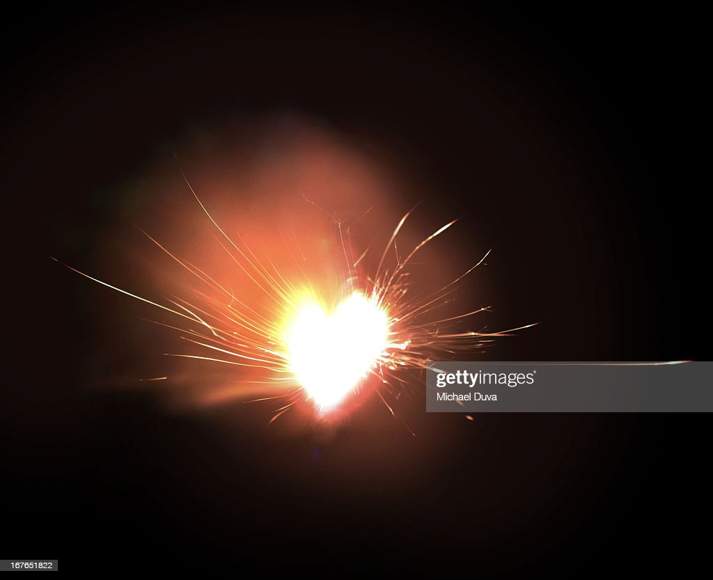 sparkler exploding heart on fire : Stock Photo