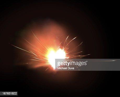 sparkler exploding heart on fire : Stock Photo