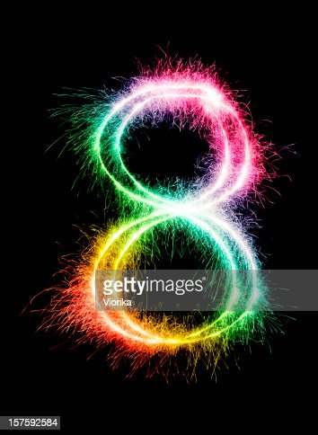 A sparkler forming the number 8 in a rainbow color