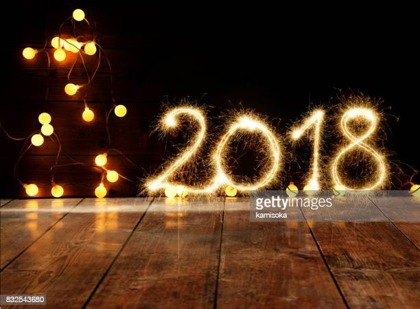 Sparkler New Year 2018 On Wooden Floor