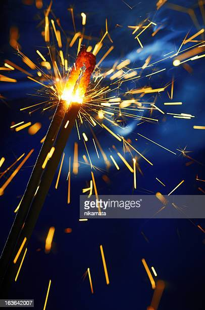 Sparkler on blue blurred background