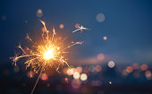 Sparkler with blurred busy city light background