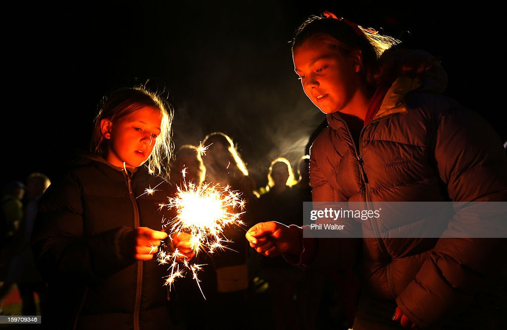 Sparklers are lit on the finish line during the Challenge Wanaka on January 19, 2013 in Wanaka, New Zealand.