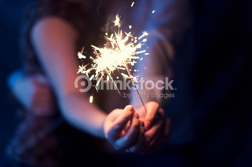 sparklers in the hands of the couple : Stock Photo