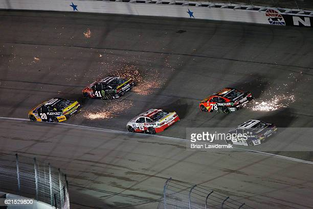 Sparks are seen as Matt Kenseth driver of the DEWALT FLEXVOLT Toyota leads a pack of cars during the NASCAR Sprint Cup Series AAA Texas 500 at Texas...