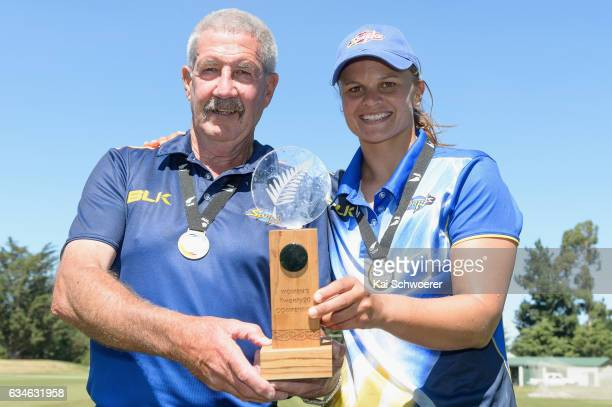 Sparks Coach Warren Lees and Suzie Bates of the Sparks pose with the trophy following the Womens Twenty20 Final match between Canterbury Magicians...