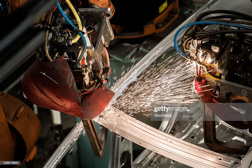 Sparks fly as an automobile chassis is welded by robotic arms inside the Mercedes-Benz AG automobile plant, operated by Daimler AG, in Kecskemet, Hungary, on Friday, April 29, 2016. Daimler's Mercedes factory will produce a new generation of compact vehicles, totalling Daimlers investment in Hungary to more than $1.8 billion. Photographer: Akos Stiller/Bloomberg via Getty Images
