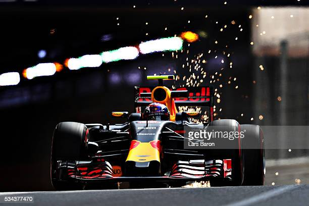 Sparks fly as Max Verstappen of the Netherlands drives the Red Bull Racing Red BullTAG Heuer RB12 TAG Heuer on track during practice for the Monaco...