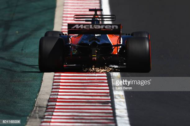 Sparks fly behind Fernando Alonso of Spain driving the McLaren Honda Formula 1 Team McLaren MCL32 on track during final practice for the Formula One...