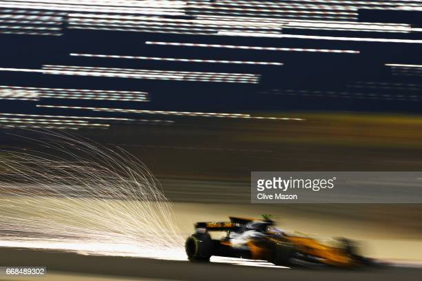 Sparks fly behind Jolyon Palmer of Great Britain driving the Renault Sport Formula One Team Renault RS17 on track during practice for the Bahrain...