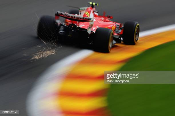 Sparks fly behind Kimi Raikkonen of Finland driving the Scuderia Ferrari SF70H on track during practice for the Formula One Grand Prix of Belgium at...