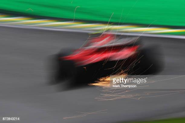 Sparks fly behind Kimi Raikkonen of Finland driving the Scuderia Ferrari SF70H on track during final practice for the Formula One Grand Prix of...
