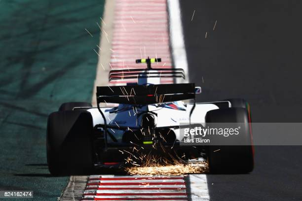 Sparks fly behind Lance Stroll of Canada driving the Williams Martini Racing Williams FW40 Mercedes on track during final practice for the Formula...